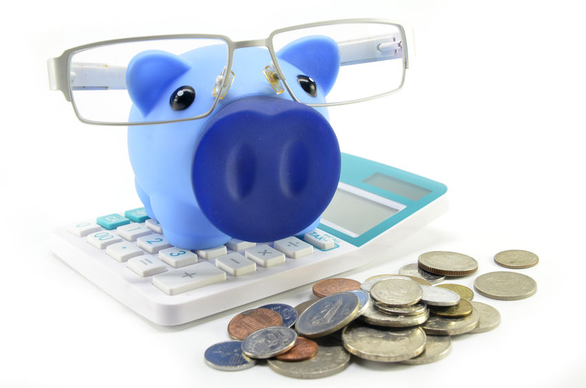 piggy bank and calculator budgeting